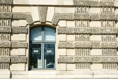 Je suis Charlie. Sculpted façade of a building in Paris where tracts with the words: Je suis Charlie are displayed on a window. April 13, 2015 -France stock photos