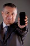 Je suis un directeur expert avec mon téléphone portable Photographie stock libre de droits