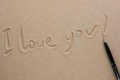Je t'aime écrit dans le stylo sur le sable Images libres de droits