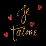 Je t`aime card with golden and red glitter effect. I love you in French. Modern brush calligraphy. Happy Valentine`s Day phrase. I. Solated on black background Royalty Free Stock Photo