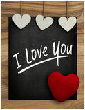 Je t'aime hangi du coeur de Valentine blanc d'amour de tableau de message Photo stock