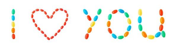 Je t'aime inscription faite de sucreries multicolores d'isolement sur le blanc Photographie stock