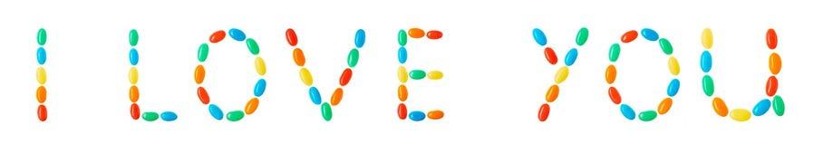 Je t'aime inscription faite de sucreries multicolores d'isolement sur le blanc Image stock