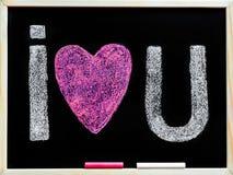 Je t'aime main de message écrite avec la craie sur le tableau noir Photo libre de droits