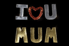 Je t'aime momie Enfantez l'image de jour du ` s contre le backgr noir Photo libre de droits