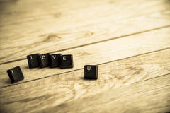 Je t'aime mot sur le floor1 en bois Images stock