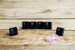 Je t'aime mot sur le floor10 en bois Photographie stock