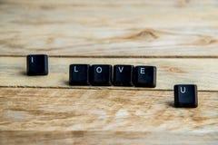 Je t'aime mot sur le floor4 en bois Photos stock