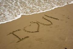 JE T'AIME sur la plage Images stock