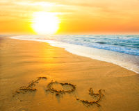 Je t'aime sur la plage de sable Photo stock