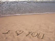 Je t'aime sur la plage sablonneuse Photographie stock libre de droits