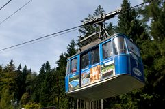 The Ještěd cable car -cabin lift with advertising Stock Photo