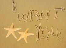 Je vous veux écrit en sable Photos libres de droits