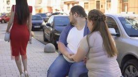 Jealous girlfriend with boyfriend on date, insecurities, couple misunderstanding. Stock footage stock video