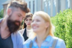 Really jealous of him. Jealous woman look at couple in love on street. Romantic couple of man and woman dating. Bearded. Really jealous of him. Jealous women stock photography