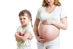 Jealous kid and her pregnant mom Royalty Free Stock Photos