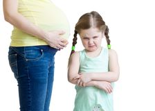Jealous kid and her pregnant mother Royalty Free Stock Photo