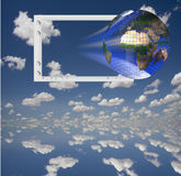 Jealous Much. Earth and Monitor with clouds Royalty Free Stock Photography