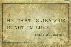 Jealous Saint Augustine. He that is jealous is not in love - quote of ancient Christian theologian and philosopher Saint Augustine printed on grunge cardboard Royalty Free Stock Image