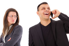 Jealous suspicious woman looking at unfaithful man talking with Royalty Free Stock Photo