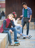 Jealous teen and his friends after conflict Stock Photo