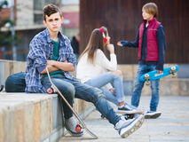 Jealous teen and his friends after conflict Stock Photos