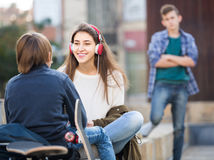 Jealous teen and his friends after conflict Royalty Free Stock Photos