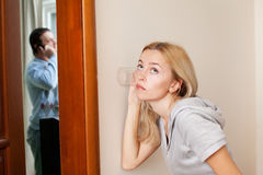Jealous wife, overhearing her husband Stock Photography