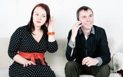 Jealous woman eavesdrop Royalty Free Stock Image