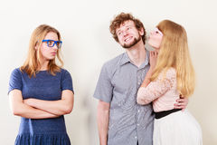 Jealous woman with happy couple Stock Photography