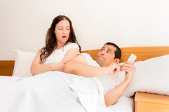 Jealous woman with her husband Stock Photography