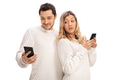 Jealous woman looking at her boyfriend's phone Royalty Free Stock Photography
