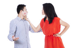 Jealous woman looking at her kissed man Stock Photo