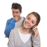 Jealous young man with girlfriend Stock Photo
