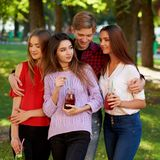 Seduction secrets, pickup, alpha male concept. Jealousy and envy in friends relationship. One macho men dating with all women on the party. Seduction secrets Stock Photo