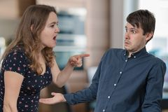 Jealousy hysterical wife is shouting and blaming her husband. royalty free stock images
