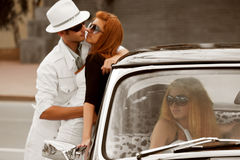 Jealousy in a retro car. Royalty Free Stock Photo
