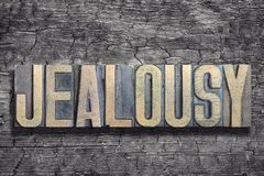 Jealousy word burned wood Royalty Free Stock Photo