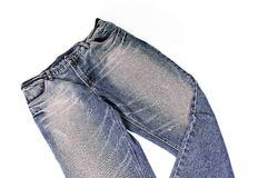 Jean. Worn blue denim jeans in white background Stock Photography