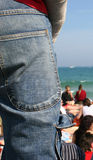 Jean. Trousers view in the beach Royalty Free Stock Photo