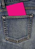 Jean back pocket and empty card. Jean texture with pocket and pink empty card Stock Photos