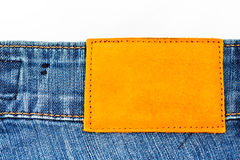Jean background with blank leather label. For filling texts Stock Photography