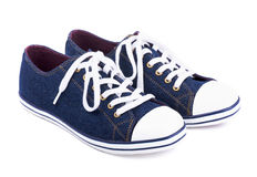 Jean blue sneakers Stock Photography