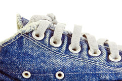 Jean canvas shoes. Old jean canvas shoes  on the background Royalty Free Stock Photo