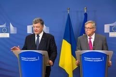 Jean-Claude Juncker och Petro Poroshenko Fotografering för Bildbyråer