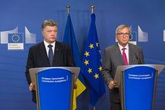 Jean-Claude Juncker och Petro Poroshenko Arkivfoto