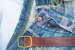 Jean clothes and folfer on wood Royalty Free Stock Photo