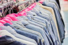 Jean clothes on racks at the show.Shallow dof Royalty Free Stock Image