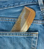 Jean and comb Royalty Free Stock Image