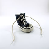 Jean fabric dog shoe with white leash Stock Image